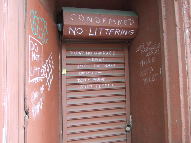 CONDEMNED NO LITTERING. Dump no garbage here. Join the human species - don't dump - even feces!